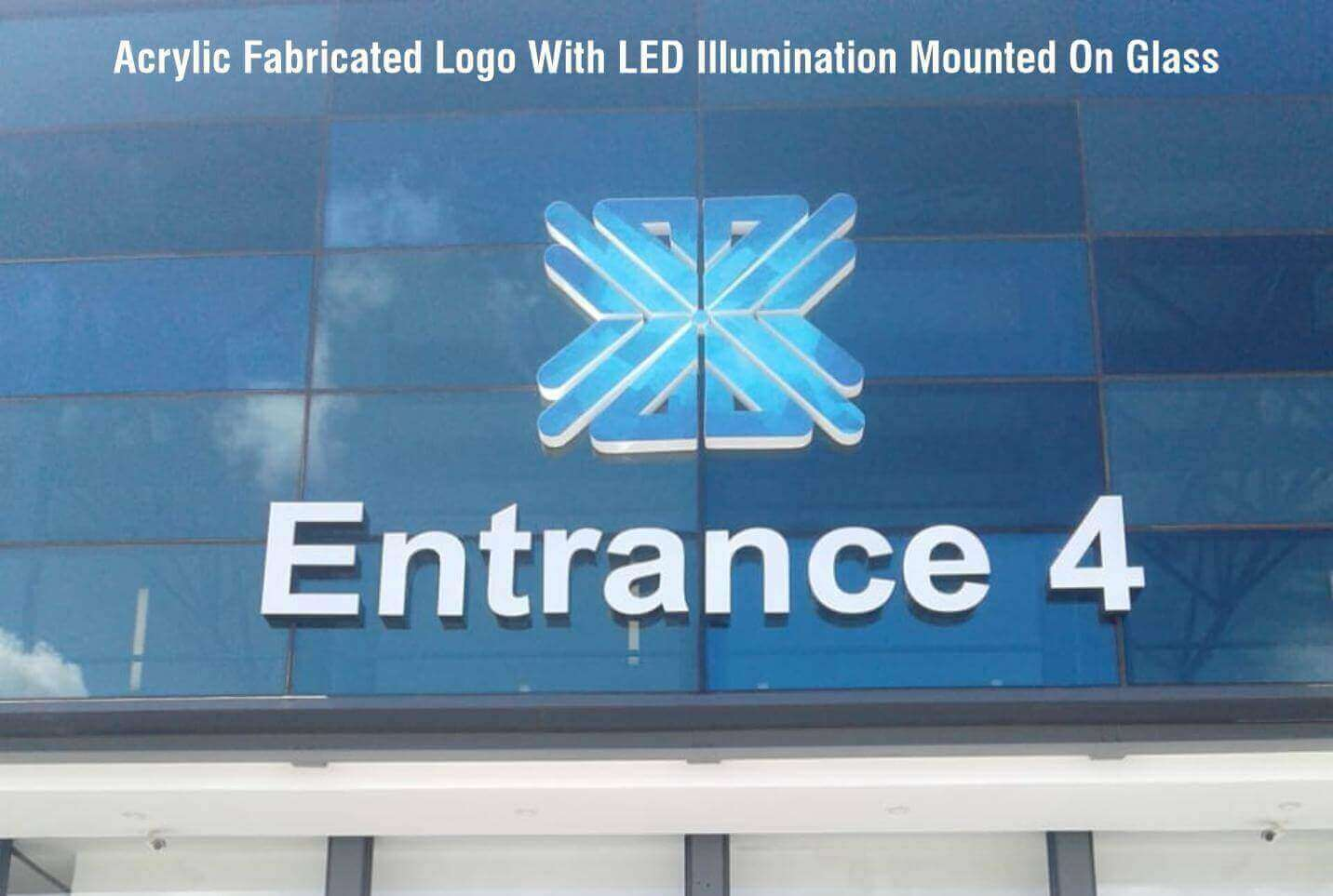Acrylic Fabricated Logo With LED Illumination Mounted On Glass
